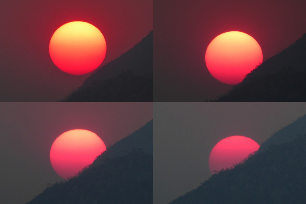 Peter-Lowenstein-Sun-changing-color-as-it-sets-through-smoke-haze-Mutare-Zimbabwe_1444582505