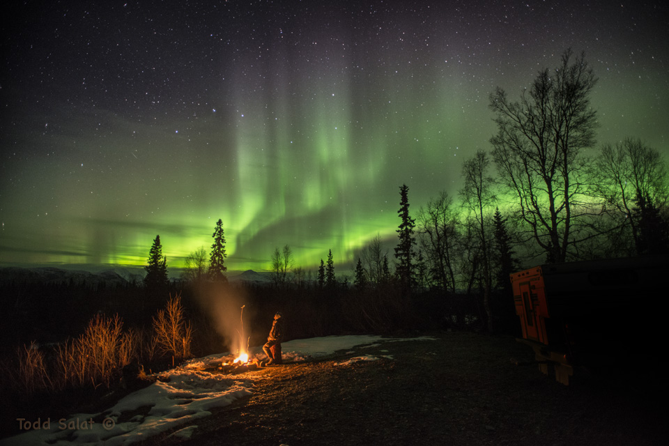 Auroras and a campfire light up my night in the Alaska Range on October 11, 2015 just before midnight.