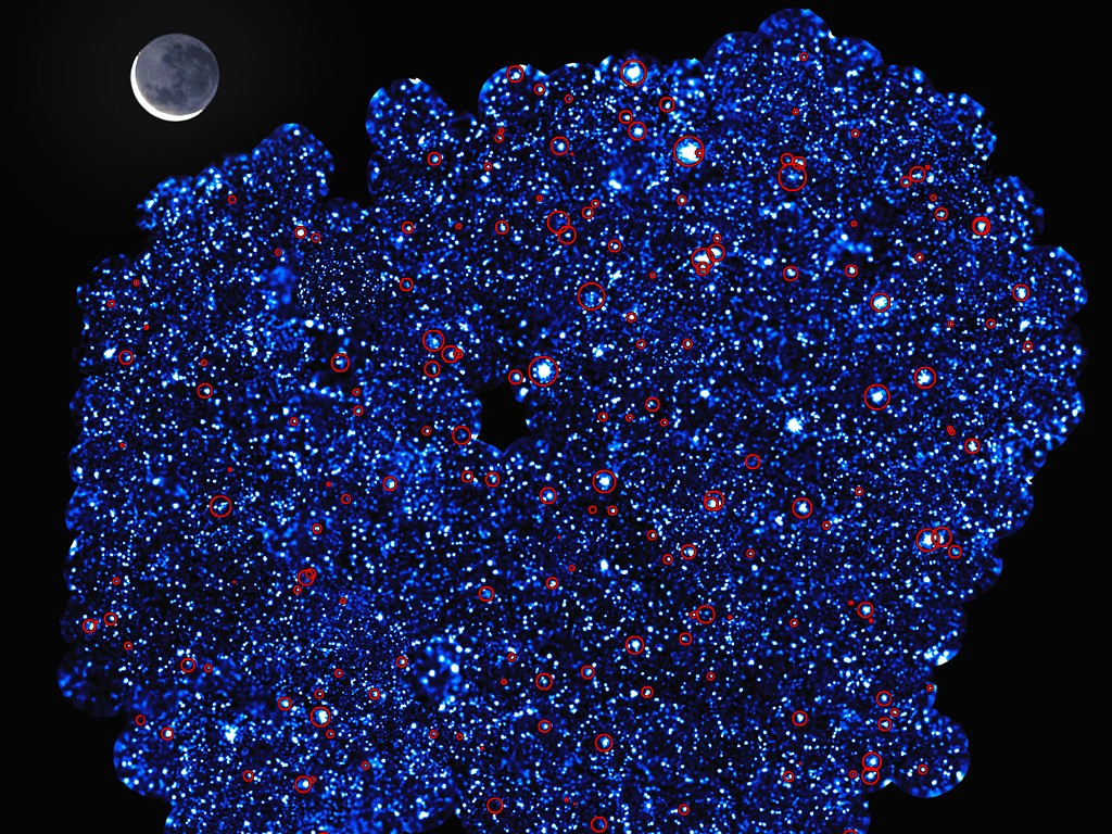 This image shows XXL-South Field (or XXL-S), one of the two fields observed by the XXL survey. XXL is one of the largest quests for galaxy clusters ever undertaken and provides by far the best view of the deep X-ray sky yet obtained. The survey was carried out with ESA's XMM-Newton X-ray observatory. Additional vital observations to measure the distances to the galaxy clusters were made with ESO facilities. The area shown in this image was obtained with some 220 XMM-Newton pointings and, if viewed on the sky, would have a two dimensional area a hundred times larger than the full Moon (which spans one half degree), and that is without taking into account the depth that the survey explores. The red circles in this image show the clusters of galaxies detected in the survey. Along with the other field — XXL-North Field (or XXL-N) — around 450 of these clusters were uncovered in the survey, which mapped them back to a time when the Universe was just half of its present age. The image also reveals some of the 12 000 galaxies that had very bright cores containing supermassive black holes that were detected in the field.