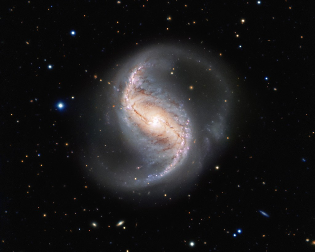 This picture of the week shows the spiral galaxy NGC 986 in the constellation of Fornax (The Furnace). The galaxy, which was discovered in 1826 by the Scottish astronomer James Dunlop, is not often imaged due to its proximity to the famous and rich Fornax Cluster of galaxies. Which is a shame, as this galaxy is not only a great scientific object, but also very pretty. The galaxy is about 56 million light-years away and seen almost perfectly from the top, or — as astronomers say — face-on. This allows us to see the two main spiral arms and also a central bar-shaped structure, composed of stars and dust, which makes it a barred spiral galaxy. Astronomical surveys have shown that about two thirds of all spiral galaxies contain a bar, including the Milky Way. This makes NGC 986 the perfect place to study the structure of galaxies and find out more about our own home galaxy, which is difficult to study from within. This view from the FORS instrument on ESO's Very Large Telescope at the Paranal Observatory in northern Chile comes from the ESO Cosmic Gems programme, an outreach initiative to produce images of interesting, intriguing or visually attractive objects using ESO telescopes, for the purposes of education and public outreach. The programme makes use of telescope time that cannot be used for science observations. All data collected may also be suitable for scientific purposes, and are made available to astronomers through ESO's science archive.