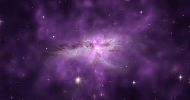 Una enorme nube caliente que envuelve a dos galaxias en colisión