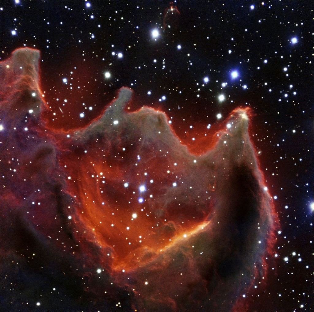 Like the gaping mouth of a gigantic celestial creature, the cometary globule CG4 glows menacingly in this image from ESO's Very Large Telescope. Although it looks huge and bright in this image it is actually a faint nebula and not easy to observe. The exact nature of CG4 remains a mystery.