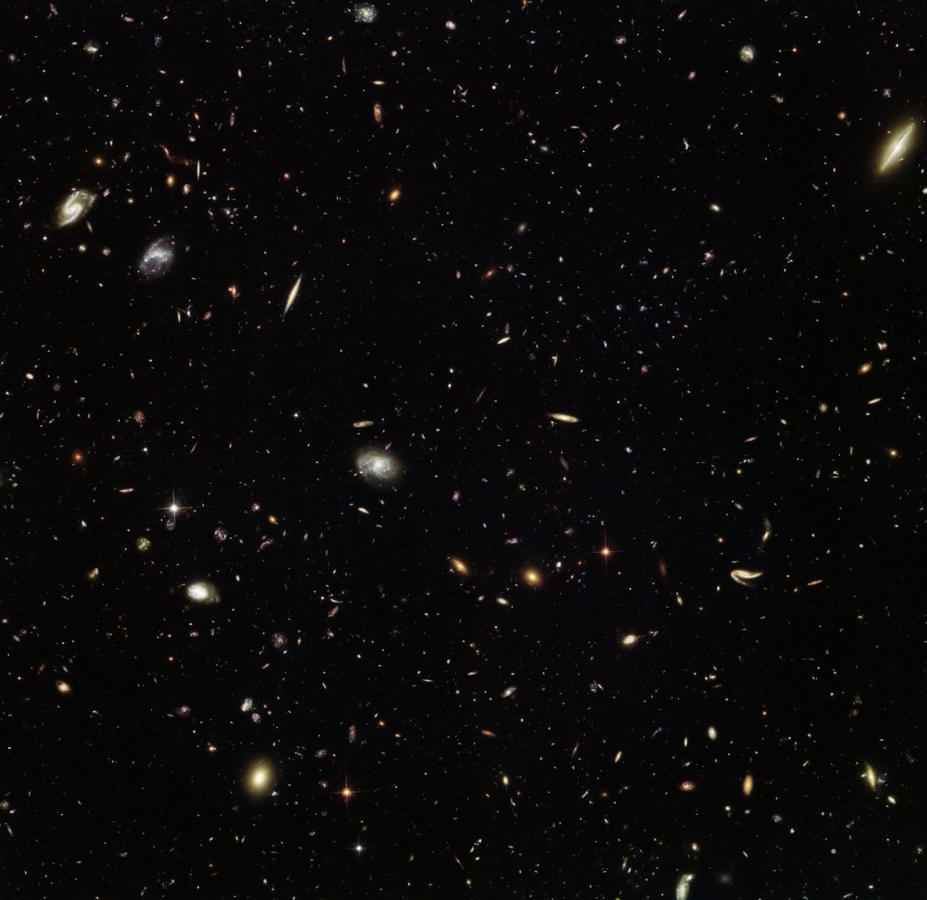 "Nearly as deep as the Hubble Ultra Deep Field, which contains approximately 10 000 galaxies, this incredible image from the NASA/ESA Space Telescope reveals thousands of colourful galaxies in the constellation of Leo (The Lion). This vibrant view of the early Universe was captured as part of the Frontier Fields campaign, which aims to investigate galaxy clusters in more detail than ever before, and to explore some of the most distant galaxies in the Universe. Galaxy clusters are massive. They can have a tremendous impact on their surroundings, with their immense gravity warping and amplifying the light from more distant objects. This phenomenon, known as gravitational lensing, can help astronomers to see galaxies that would otherwise be too faint, aiding our hunt for residents of the primordial Universe. MACS J1149.5+2223 is a galaxy cluster located approximately five billion light-years away. In 2012, it helped astronomers uncover one of the most distant galaxies ever discovered. Light from the young galaxy, magnified 15 times by the galaxy cluster, first shone when our 13.7-billion-year-old Universe was a mere 500 million years old — just 3.6 per cent of its current age! In 2014 and 2015, MACS J1149.5+2223 was observed as part of the Frontier Fields campaign. While one of Hubble's cameras observed the galaxy cluster itself, another simultaneously captured the spectacular scene pictured above, of an ""unremarkable"" patch of space. Referred to as a parallel field, this image — when compared to other similar fields — will help astronomers understand how the Universe looks in different directions."