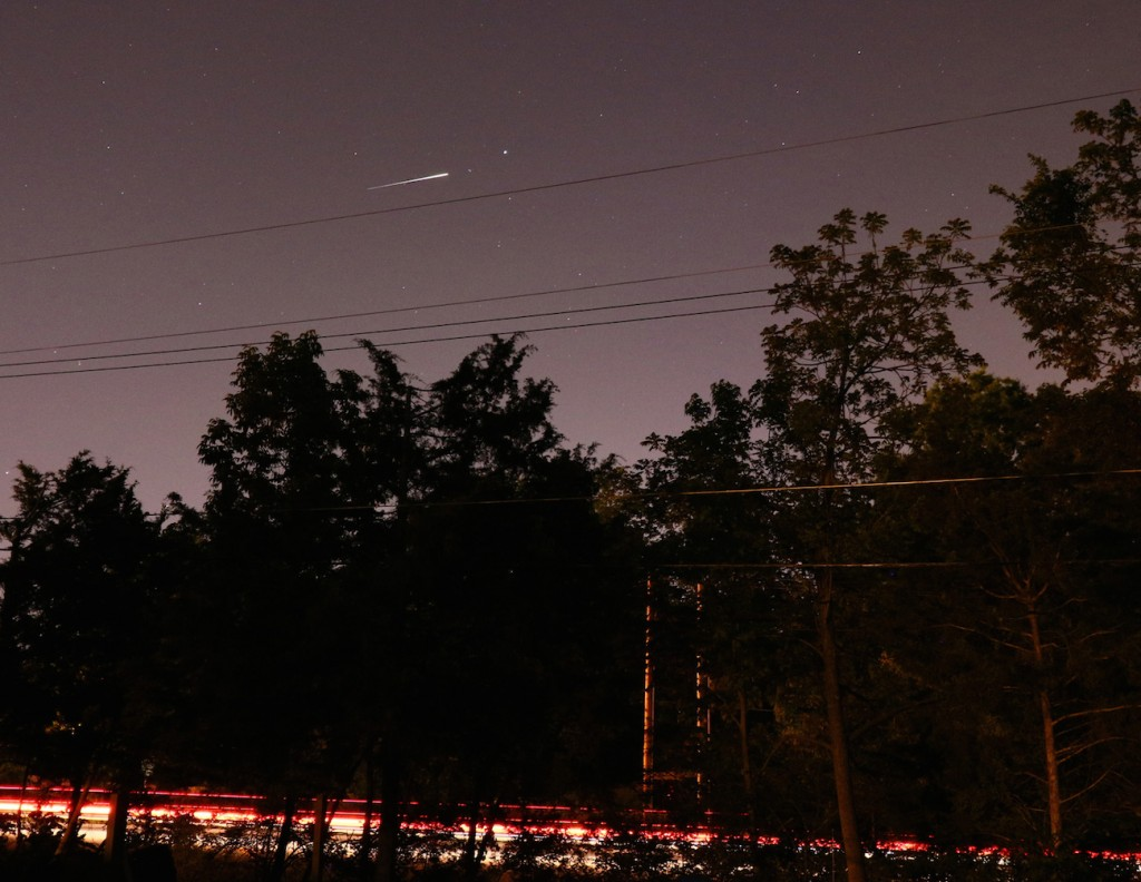 Just about worst-case for me is an Iridium Flare in the northeast, straight over downtown Columbia, Missouri, about a mile and a half away.  That's Vega just to the right of the flare.
