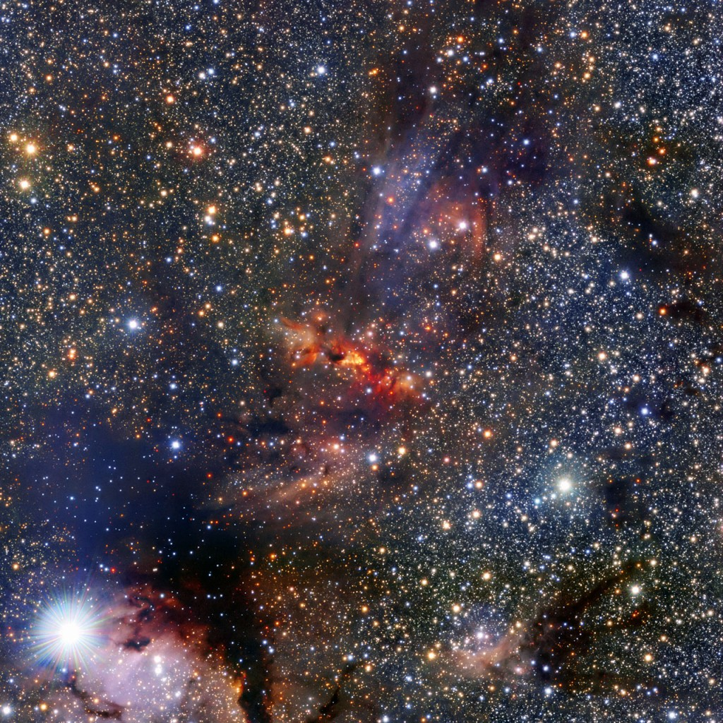 This image shows a region of the Milky Way that lies within the constellation of Scorpius, close to the central plane of the galaxy. The region hosts a dense cloud of dust and gas associated with the molecular cloud IRAS 16562-3959, clearly visible as an orange smudge among the rich pool of stars at the centre of the image. Clouds like these are breeding grounds for new stars. In the centre of this cloud the bright object known as G345.4938+01.4677 can just be seen beyond the veil of gas and dust. This is a very young star in the process of forming as the cloud collapses under gravity. The young star is very bright and heavy —  roughly 15 times more massive than the Sun — and featured in a recent Atacama Large Millimeter/submillimeter Array (ALMA) result. The team of astronomers made surprising discoveries within G345.4938+01.4677 — there is a large disc of gas and dust around the forming star as well as a stream of material flowing out from it. Theories predict that neither such a stream, nor the disc itself, are likely to exist around stars like G345.4938+01.4677 because the strong radiation from such massive new stars is thought to push material away. This image was made using the Visible and Infrared Survey Telescope for Astronomy (VISTA), which is part of ESO's Paranal Observatory in the Atacama Desert of Chile. It is the world's largest survey telescope, with a main mirror that measures over four metres across. The colour image was produced by the VVV survey, which is one of six large public surveys that are devoted to mapping the southern sky. The bright star in the bottom left of the image is known as HD 153220.