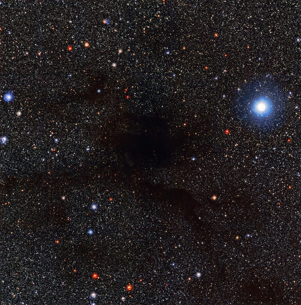 The Wide Field Imager (WFI) on the MPG/ESO 2.2-metre telescope at the La Silla Observatory in Chile captured this view of dark cloud Lupus 4 blotting out background stars. Lupus 4 is a dense pocket of gas and dust where new stars are expected to form. The cloud is located about 400 light-years away from Earth, on the border between the constellations of Lupus (The Wolf) and Norma (The Carpenter's Square).