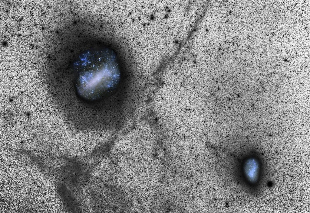 Each of the thousands of spots in this new image represents a distant star, and the glittering blue holes reveal glimpses of our neighbouring galaxies, the Large and Small Magellanic Clouds. Although this image looks as if it was made on a large scale telescope it was in fact captured from ESO's La Silla Observatory using a portable setup consisting of a SBIG STL-11000M CCD camera and a Canon prime lens. It was presented in a scientific paper alongside state-of-the art simulations, in an exciting example of how a small camera, a fast lens, a long exposure time and one of the world's best astronomical sites can reveal huge faint features better than even a big telescope. This deep image was captured using the LRGB method, and provides an insight into the actual process of creating spectacular astrophotography. Many challenges face those attempting to photograph the night sky, including interference from light sources other than the object being photographed, and capturing objects in sufficient depth. Trying to maximise the signal received from the target, whilst minimising input from other sources — known as noise — is a crucial aspect of astrophotography. The optimisation of the signal to noise ratio is far more easily achieved in black-and-white than in colour. Therefore a clever trick often employed to capture a high-quality image is the use of a luminance exposure, which produces richly detailed monochrome images like the one seen here. Colour details from images taken through colour filters can then be overlaid or inset, as the Magellanic Clouds have been here. Link:  Science Paper