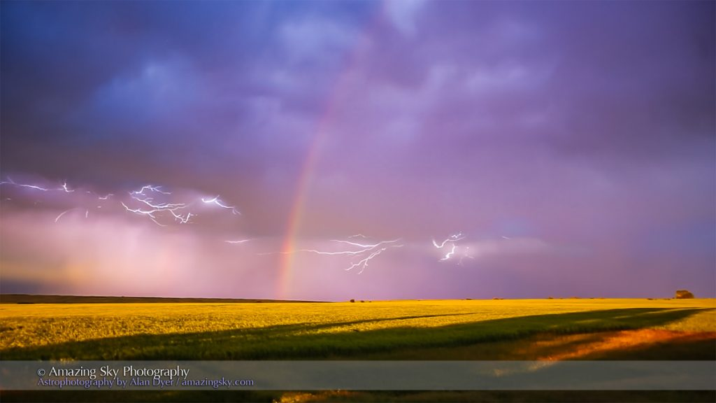 Lightning bolts and a rainbow at sunset in a thunderstorm retreating over the Alberta prairie, July 18, 2016. There is a faint outer bow visible at left.  This is a stack of 35 consecutive video frames taken with HD (1920 x 1080) resolution at 30 frames per second with the Canon 6D, and extracted as an image sequence with Photoshop, then processed in Adobe Camera Raw, then stacked with Russell Brown's Stack-A-Matic into a smart object with maximum stack mode, to accumulate the frames taken over about 1 second into one still frame. So I could have got this with a single 1-secind exposure with the lens stopped way down and a ND filter, but my timing would have had to have been very, very lucky!