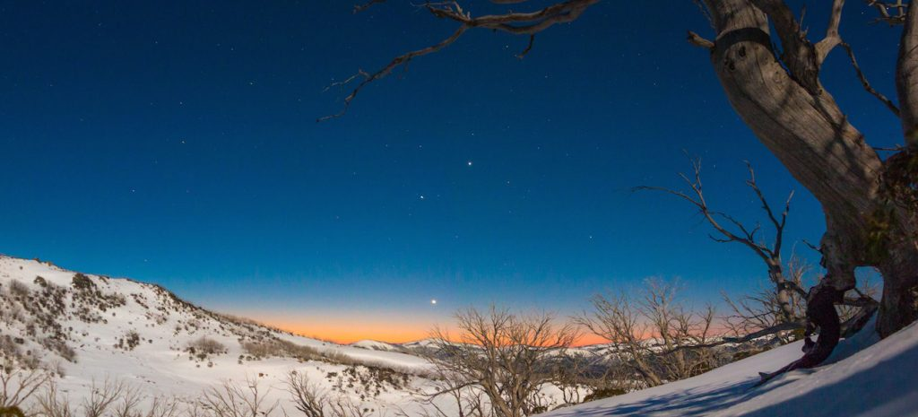 Venus, Mercury and Jupiter (bottom to top) align in the evening sky from near the 'Schlink Hilton' hut in Australia's Snowy Mountains. Image captured under nearly Full Moon light, looking towards the distant Grey Mare Range.