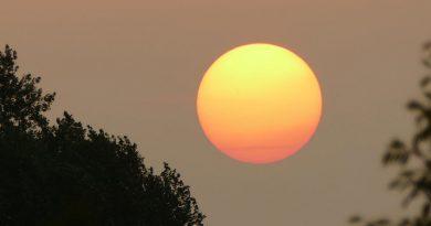 La puesta de Sol desde Denderleeuw, Bélgica