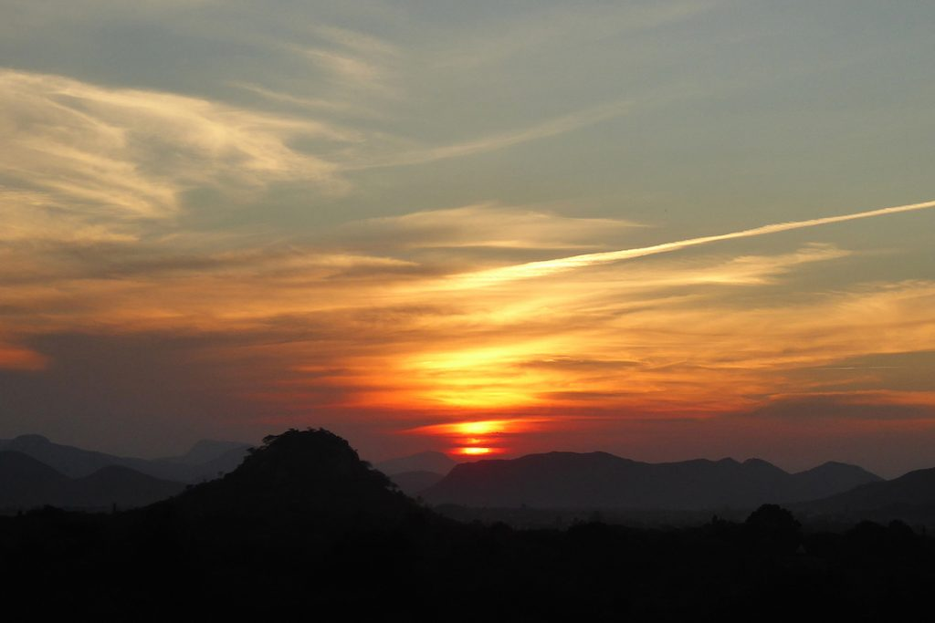 peter-lowenstein-sunset-below-persistent-contrail-mutare-zimbabwe_1479944949