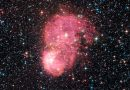 Una galaxia satélite de la Vía Láctea iluminada por una nebulosa de emisión