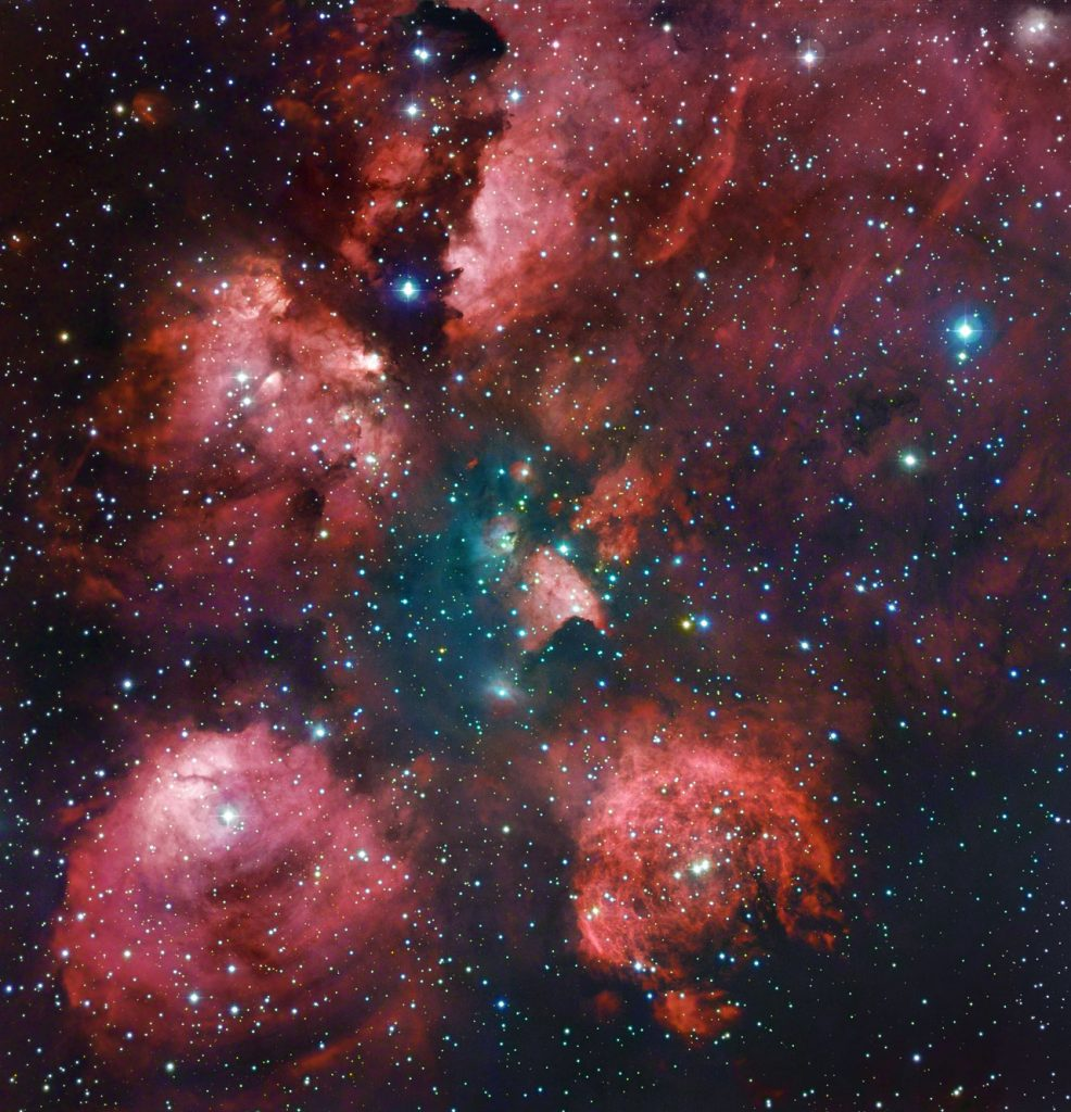 """The Cat's Paw Nebula is revisited in a combination of exposures from the MPG/ESO 2.2-metre telescope and expert amateur astronomers Robert Gendler and Ryan M. Hannahoe. The distinctive shape of the nebula is revealed in reddish puffy clouds of glowing gas against a dark sky dotted with stars. The image was made by combining existing observations from the 2.2-metre MPG/ESO telescope of the La Silla Observatory in Chile (see ESO Photo Releaseeso1003) with 60 hours of exposures on a 0.4-metre telescope taken by Gendler and Hannahoe. The resolution of the existing 2.2-metre MPG/ESO telescope observations was combined (by using their """"luminance"""" or brightness) with the colour information from Gendler and Hannahoe's observations to produce a beautiful combination of data from amateur and professional telescopes. For example, the additional colour information brings out the faint blue nebulosity in the central region, which is not seen in the original ESO image, while the ESO data contribute their finer detail. The result is an image that is much more than the sum of its parts. The well-named Cat's Paw Nebula (also known as NGC 6334) lies in the constellation of Scorpius (The Scorpion). Although it appears close to the centre of the Milky Way on the sky, it is relatively near to Earth, at a distance of about 5500 light-years. It is about 50 light-years across and is one of the most active star formation regions in our galaxy, containing massive, young brilliant blue stars, which have formed in the last few million years. It is host to possibly tens of thousands of stars in total, some of them visible and others still hidden in the clouds of gas and dust. Links  Robert Gendler's website"""