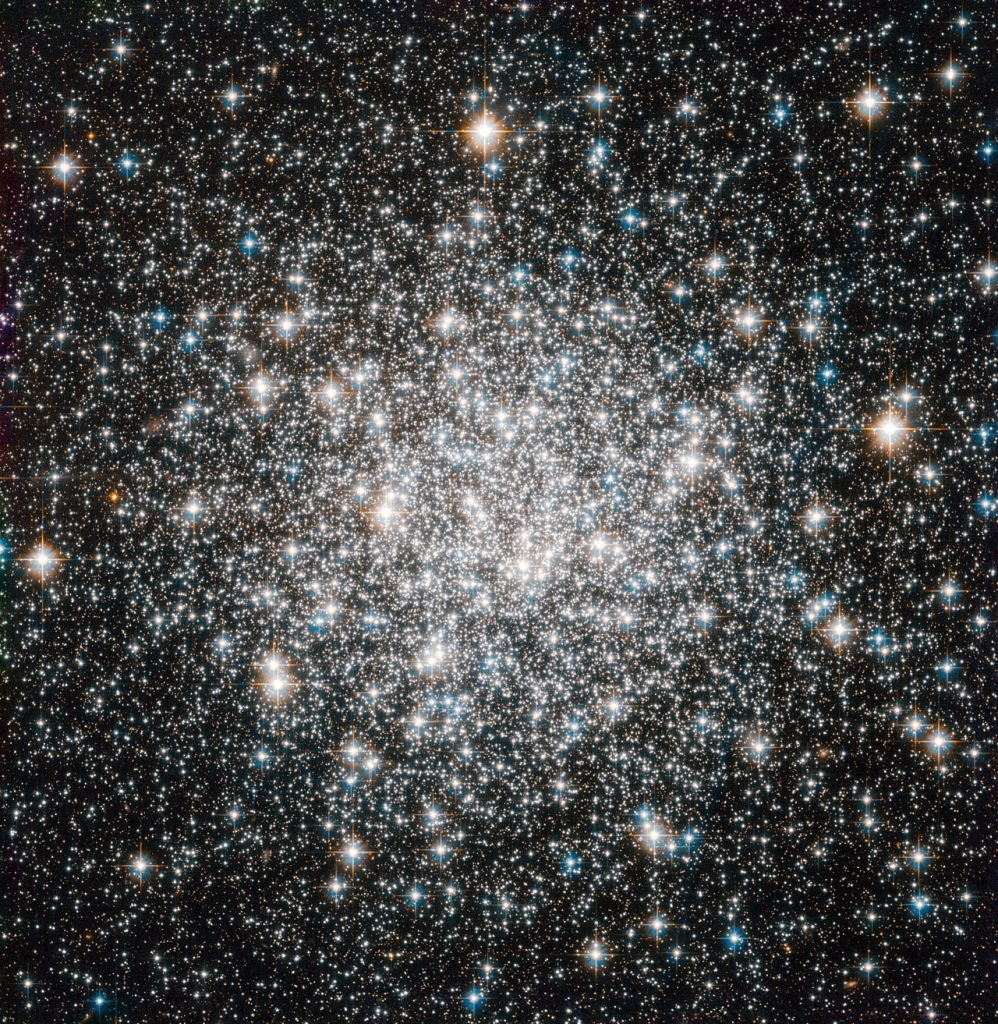The NASA/ESA Hubble Space Telescope offers this delightful view of the crowded stellar encampment called Messier 68, a spherical, star-filled region of space known as a globular cluster. Mutual gravitational attraction amongst a cluster's hundreds of thousands or even millions of stars keeps stellar members in check, allowing globular clusters to hang together for many billions of years. Astronomers can measure the ages of globular clusters by looking at the light of their constituent stars. The chemical elements leave signatures in this light, and the starlight reveals that globular clusters' stars typically contain fewer heavy elements, such as carbon, oxygen and iron, than stars like the Sun. Since successive generations of stars gradually create these elements through nuclear fusion, stars having fewer of them are relics of earlier epochs in the Universe. Indeed, the stars in globular clusters rank among the oldest on record, dating back more than 10 billion years. More than 150 of these objects surround our Milky Way galaxy. On a galactic scale, globular clusters are indeed not all that big. In Messier 68's case, its constituent stars span a volume of space with a diameter of little more than a hundred light-years. The disc of the Milky Way, on the other hand, extends over some 100 000 light-years or more. Messier 68 is located about 33 000 light-years from Earth in the constellation Hydra (The Female Water Snake). French astronomer Charles Messier notched the object as the sixty-eighth entry in his famous catalogue in 1780. Hubble added Messier 68 to its own impressive list of cosmic targets in this image using the Wide Field Camera of Hubble's Advanced Camera for Surveys. The image, which combines visible and infrared light, has a field of view of approximately 3.4 by 3.4 arcminutes.