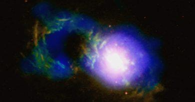 La tempestad cósmica producida por un agujero negro en una galaxia diminuta